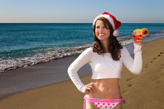 Bikini girl with drink on the beach during Christmas vacation Royalty Free Stock Images