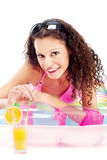 Bikini girl drinking juice Royalty Free Stock Image