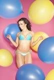 Bikini girl holding balloons . Royalty Free Stock Images