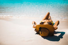 Bikini girl holding hat and lie down at the beach. Bikini girl holding hat and lie down at the Ra-Cha beach Stock Photo