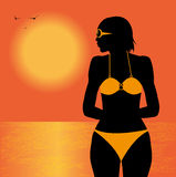 Bikini girl. Silhouette of girl in bikini on the beach Stock Photography