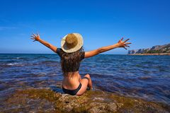 Bikini girl in summer Mediterranean beach having fun. Sit open arms excited stock images