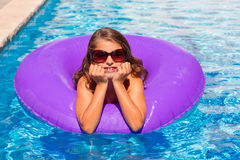 Bikini girl with sunglasses and inflatable pool ring Royalty Free Stock Photo
