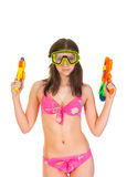 Bikini girl with two water gun Royalty Free Stock Images