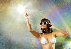 Bikini girl wearing headphones Stock Image