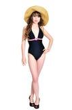 Bikini girl wearing straw hat royalty free stock photos