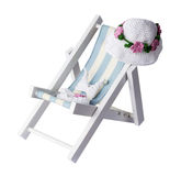 Bikini and hat on beach chair isolated on white background with. Clipping path Stock Photos