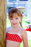 Bikini kid girl water wet in pool garden Royalty Free Stock Image