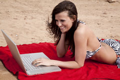 Bikini and laptop Royalty Free Stock Images