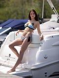 Bikini Model on Boat. Outdoor photo of sexy woman in bikini standing on a boat Stock Image
