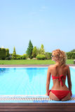 Bikini model in pool with clear blue water Royalty Free Stock Photos
