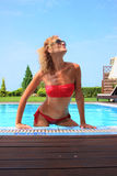 Bikini model in pool with clear blue water Royalty Free Stock Photo