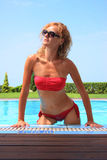 Bikini model in pool with clear blue water Royalty Free Stock Images