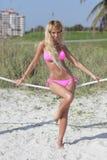 Bikini model posing by the dunes Stock Images