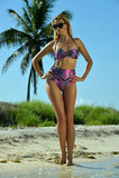 Bikini model posing sexy in front of palm tree Stock Photo
