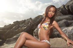 Bikini model on the rocks Royalty Free Stock Image