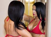 Bikini model w lustrze Obraz Royalty Free