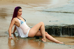 Bikini model with a wet shirt on the beach Royalty Free Stock Images