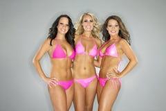 Bikini Models. Wearing pink bikinis in a studio environment Royalty Free Stock Photos
