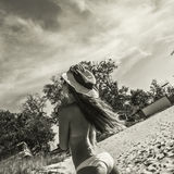 Bikini woman in sunglasses and a hat. royalty free stock image