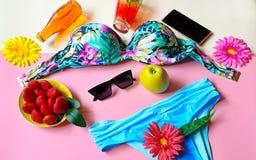 Bikini Summer Girl women clothes beach beachwear sunglasses bag juice iphone  wildflowers travel holiday strawbery  on yellow pla. Still Life Bikini Summer Girl stock photo