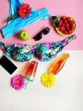 Bikini Summer Girl women clothes beach beachwear sunglasses bag juice iphone  wildflowers travel holiday strawbery  on yellow pla. Bikini Summer Girl women royalty free stock photography