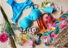 Bikini Summer Girl women clothes beach bikini sunglasses bag juice lemon iphone seashell wild flowers travel holiday tourism relax. Blue ,green,red colorful stock photo