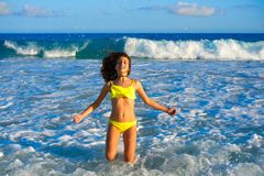 Bikini girl jumping in Caribbean sunset beach. Bikini teen girl jumping happyt in Caribbean sunset beach splashing shore stock photos