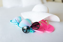 Bikini top, hat, flip-flop and sunglasses Royalty Free Stock Photos