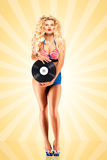 Bikini und Vinyl stockbild