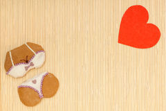 Bikini underwear shape gingerbread cake cookie red heart love symbol Stock Images