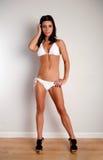 Bikini wall pose Stock Image