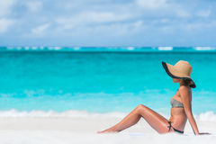 Bikini woman beach vacation sun tanning Royalty Free Stock Photo