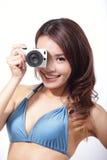 Bikini woman with camera Stock Image