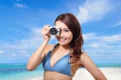 Bikini woman with camera Royalty Free Stock Photos