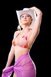 Bikini woman with cowbow hat. Blond Caucasian woman in floral bikini wearing a white cowboy hat Stock Photography