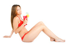Bikini woman drinking a cocktail Royalty Free Stock Photography