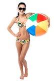 Bikini woman holding colorful beach ball Stock Photo