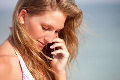 Bikini woman on the phone Stock Image