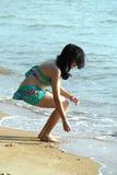 Bikini Woman Playing Water on Beach Stock Photography