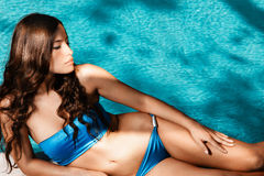 Bikini woman by the pool Stock Image