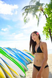 Bikini woman renting surfboard in Waikiki beach Royalty Free Stock Photos