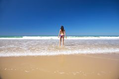 Bikini woman at seashore Royalty Free Stock Photography