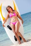 Bikini woman with surfboard Stock Images