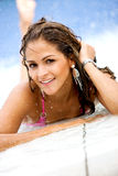 Bikini woman by a swimming pool Royalty Free Stock Photo