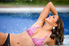 Bikini woman by a swimming pool Royalty Free Stock Image