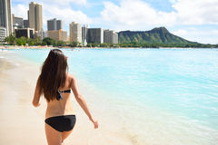 Bikini woman on Waikiki Beach, Oahu, Hawaii. USA. Girl on travel vacation holidays running having fun on Hawaiian Waikiki beach with Diamond Head mountain stock photography