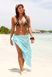 Bikini woman walking Stock Images