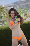 Bikini woman with water gun Stock Photography