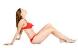 Bikinikvinna på vit bakgrund arkivbild